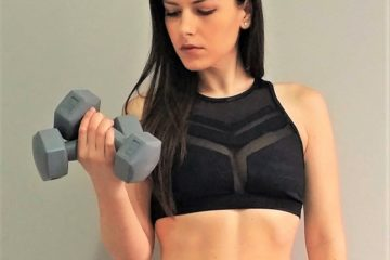 Fay holding fitness weights