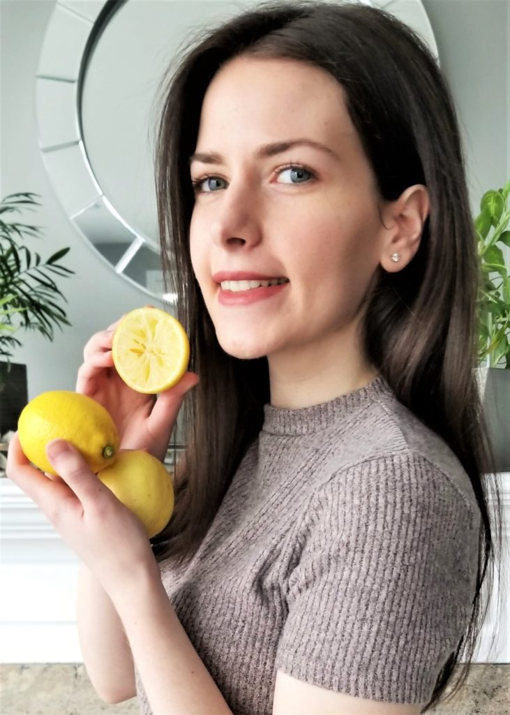 Fay posing with lemons in hand