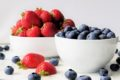 bowls of strawberries and blueberries