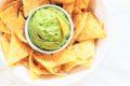 bowl of guacamole and tortilla chips