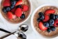 two bowls of oatmeal with berries on top
