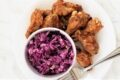 image of plate with chicken wings and coleslaw